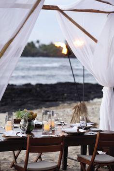 Your table's set at Four Seasons Resort Hualalai at Historic Ka'upulehu. Feel free to stay past sundown.