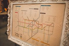 I love the framed table plan that's modeled after the London map