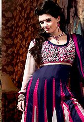 Take the fashion industry by storm in this beautiful embroidered suit. The dazzling navy blue, off white and pink georgette, satin and crepe churidar suit have amazing embroidery patch work is done with resham, zari and lace work. Beautiful embroidery work on kameez is stunning. The entire ensemble makes an excellent wear. Matching dark pink santoon churidar and shaded navy blue and pink chiffon dupatta is available with this suit. Slight Color variations are possible due to differing screen…