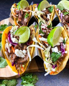Healthy pork carnitas served over Mexican slaw in crispy corn tortillas and topped with fresh cilantro, lime, and goat cheese. Pork Carnitas Tacos, Pork Carnitas Recipe, Slaw Recipes, Mexican Food Recipes, Healthy Recipes, Healthy Food, Slaw For Tacos, Mexican Slaw, Recipes