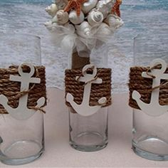 Easy DIY Center piece - The Nautical Vases are wrapped in premium natural fiber rope and completed with a white anchor with rope wrapped around it. Anchor Baby Showers, Nautical Bridal Showers, Nautical Party, Navy Party, Beach Wedding Reception, Our Wedding, Anchor Centerpiece, Vase Centerpieces, Anchor Wedding
