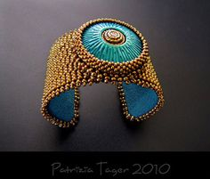 Bead and polymer clay cuff by Patrizia Tager