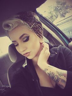 Rockabilly style.... I need a hairstylists.... I can never get a victory roll to look that good lol