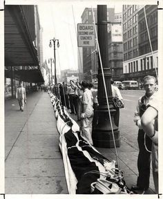 Workers line Woodward Avenue as they get ready to raise the largest flag in the world at Hudson's downtown department store in Detroit.