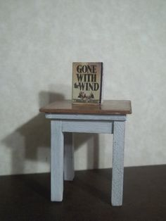Dollhouse Miniature White and Maple Side End Table with Book. $12.00, via Etsy.