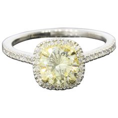 Fancy Light Yellow Canary Diamond gold platinum Halo Ring | See more rare vintage Engagement Rings at https://www.1stdibs.com/jewelry/rings/engagement-rings