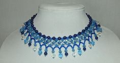 Shades of Blue Hand Woven Choker with Light Blue Cats Eye, Dark Blue Glass Pearls, and Blue and Clear Swarovski Crystals