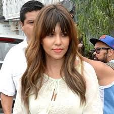 Kourtney Kardashian center parted bangs