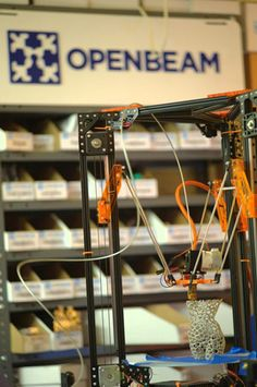 Terrance Tam, designer of the OpenBeam Construction System, has launched the OpenBeam Kossel Pro on Kickstarter.  It is based on Johann Rocholl's Kossel, an open source delta robot FFF 3D Printer.  The Kossel Pro is larger than the original Kossel and uses Metrix Brainwave Electronics, designed by Matthew Wilson and named after the makerspace where the prototypes were built.  It will be open hardware, but not self-replicating.  All its parts will be made via traditional manufacturing.