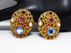New Listings Daily - Follow Us for UpDates -  Filigree Clip on Earrings - Simulated Pearls & Fuchsia Pink Rhinestones  - Signed West Germany  - #Vintage Era 1960's European #Jewelry offered by TheJewelSeeker  Lovely earr... #vintage #jewelry #teamlove #etsyretwt #ecochic #thejewelseeker