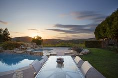 Take a look at this gorgeous views! Take a swim, sit back and relax while watching the sun set in this luxury home.  #pool #crystalclear #backyard #sunset #views #beautiful #luxury #paradise #homes