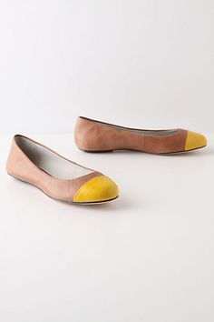 Tan and yellow flats from anthropologie. I NEED these!