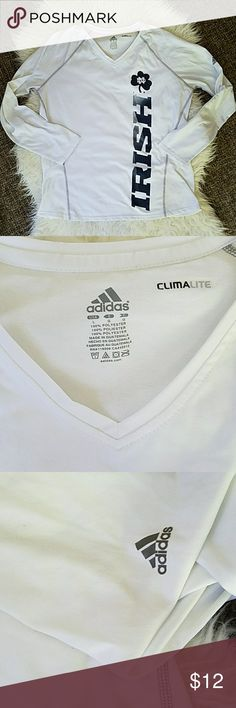 🏈🆕LISTING! Adidas Notre Dame Fighting Irish Top Adidas Notre Dame Fighting Irish Top. White with Blue Print. Small spot, tried to picture in 4th pic but it barely shows up on camera (can barely see in person). Clima-lite long sleeve.  Offers/bundles welcomed! Use the filter button in my closet, as I have many different sizes/styles.   See my page for more! adidas Tops Tees - Long Sleeve