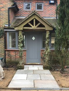 I can, with a huge smile on my face, say that we are now inside our new home! The last two weeks of January have been a massive effort but we did it – we ARE IN! Cottage Front Doors, House Front Door, House With Porch, Porch Uk, Porch Roof, Porch Veranda, Porch Designs Uk, Front Porch Design, Porch Extension