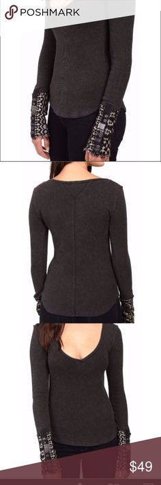 Free People Art School Cuff thermal Black M Contrasting cuffs give stunning complement to this Free People™ top. Soft waffle knit in a fitted silhouette. Plunging V-neckline. Long sleeves with 6-button detail at the cuffs. Curved hemline. Body: 57% cotton, 38% polyester, 5% spandex; Sleeve: 53% nylon, 26% acrylic, 17% merino wool, 4% spandex; Trim: 55% rayon, 33% cotton, 12% flax linen. Machine wash and dry flat. Imported. Measurements: Length: 25 in Free People Tops Tees - Long Sleeve