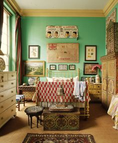 Light green wall with contrasting trim that is between a camel and tan in color with a shade of white ceiling. Great combination.