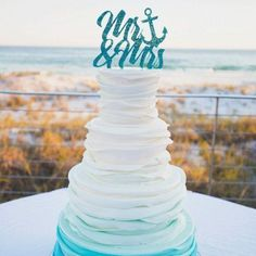 Our nautical Mr & Mrs cake topper is a beautiful and romantic way to adorn your beach or sailing style wedding cake. This cake topper is also available in glitter! Our custom designed cake topper is a