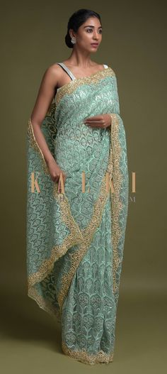 Buy Online from the link below. We ship worldwide (Free Shipping over US$100)  Click Anywhere to Tag Tea Green Saree In Net Adorned With Turq Thread Embroidered Floral Heritage Pattern Online - Kalki Fashion Tea green saree in net adorned with turq thread embroidered floral heritage pattern along with kundan and pearls.Border enhanced with zardozi and sequins embroidery in floral.