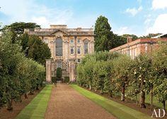 An apple allée leads to Easton Neston, a 1702 house in Northamptonshire, England.