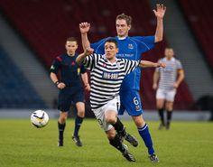 Shaun Fraser evading the tackle of the Elgin City defender