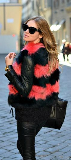 Texture. The fur on this jacket is used in different colours to bring attention to the top of her outfit!