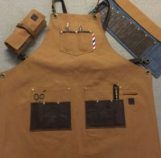 reversible barber apron made out of 12 oz 100% cotton canvas on one side and light weight poly/cotton black twill on the other side with plenty