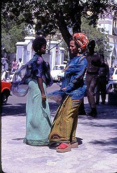 Somali Traditional Dress & Attires Young SOmali women wearing traditional clothe and doing their daily errands