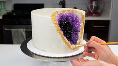 Geode cake tutorial! All you need is some rock candy and a bit of gel food coloring! It's so much easier than you'd think
