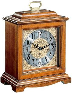"""Traditional American styled bracket clock made from hardwoods in a classic oak finish. Brass 8-day key wound movement plays 4/4 westminster chimes. Also available with a quartz dual chime movement which chimes the quarter hours and strikes the full hour. It plays either Westminster or ave maria chimes. Measures: 13-3/4"""" x 11-1/4"""" x 6-1/8"""" - Three year warranty - Free shipping within the contiguous United States.  Available at http://www.theisenclock.com/corporate_gifts_clocks.html"""