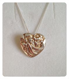 A fine silver clay patterned heart pendant (slight liver of sulphur for the colour)