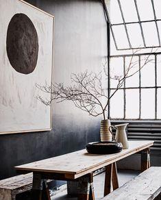 Wooden table. Huge paneled windows