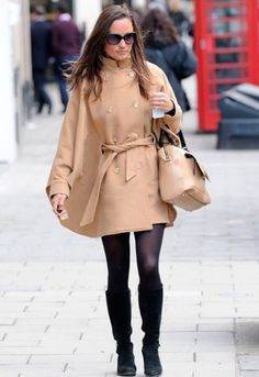 Pippa Middleton looked simple and chic while out and about in London in a nude patent bag, black tights and boots and a Somerset by Alice Temperley for John Lewis Camel Cape Coat.  Her camel cape coat is a feminine take on military-inspired, crafted from Italian cashmere. It features side pockets, a double-breasted silhouette, metallic tone buttons and a tie belt.