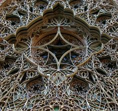 Eric Standley works with hundreds of layers of colored paper creating intricate laser cut stain glass windows.