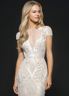 Style 6657 Vionnet Hayley Paige bridal gown - Ivory beaded net fit to flare bridal gown, allover floral baroque embellishment, illusion bateau neckline with cap sleeve and open back, full skirt with rounded net godets and nude lining.