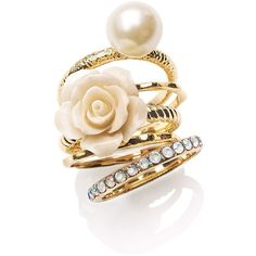 Ariella Collection Flower & Faux Pearl Stack Rings (Set of 5)... ❤ liked on Polyvore