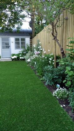 artificial easy grass lawn summer house sandstone paving and white flower planting scheme (6)