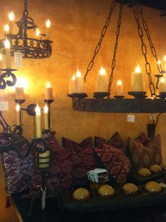 Adonis chandelier laura lee designs with geometric pillows .. Laura luna