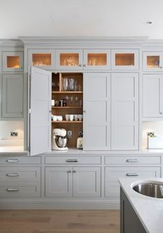 Gray cabinetry, natural wood interior