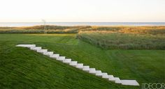 Concrete stairs down a grassy hill. Pinned to Garden Design - Paving & Stairs by Darin Bradbury.