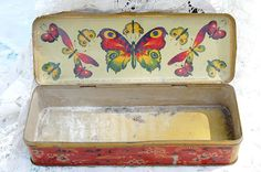 vintage French tin with butterflies inside the lid