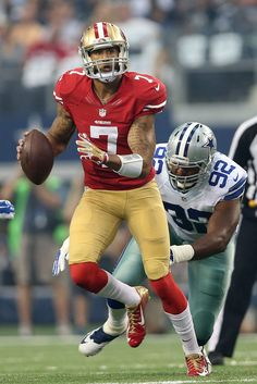 Colin Kaepernick of the San Francisco looks down field as Jeremy Mincey of  the Dallas Cowboys gives chase in the first half at AT T Stadium on  September ... f0afe951c65