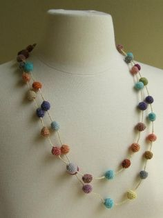 Lovely long Boules Minus linen necklace, hand crocheted from Sophie DIgard. Can be worn super long, or wrapped, bright pops of color on superlight necklace! Crochet Ball, Hand Crochet, Knit Crochet, Textile Jewelry, Fabric Jewelry, Jewellery, Jewelry Crafts, Handmade Jewelry, Crochet Earrings