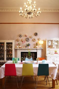 Laura's Bright and Beautiful Victorian Duplex in Glasgow: some of my favorite things -- mismatched dining chairs, chandelier, and interesting collections (not exactly my style but it's the principles)