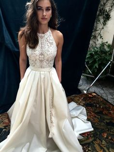 Elegant Halter Sleeveless Sweep Train Ivory Satin Wedding Dress With Lace Pockets