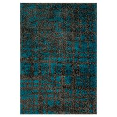 Add a pop of pattern to your living room or den with this artfully crafted shag rug, showcasing a grid-inspired motif in charcoal and dark teal....