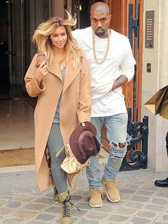 New mom and dad Kim Kardashian and Kanye West stay close and casual in the City of Light on Saturday amid Paris Fashion Week.