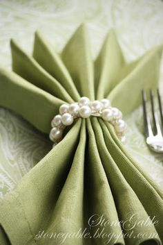 I think this is so elegant with the pearls used as a napkin ring.