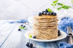 Delicious pancakes with fresh blueberries by Iryna Melnyk Photography on @creativemarket