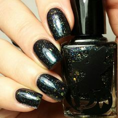 Frenzy Polish - Squad 451 | Mockingjay Collection | November 24, 2015 | A black jelly base with silver and gold holographic microglitters and a blue to purple shifting shimmer.