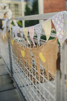 bunting can 'cute' anything up http://www.weddingchicks.com/2013/11/26/gold-and-gray-wedding/